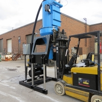 Powerlift Elevator Series being raised by forklift to upright position.